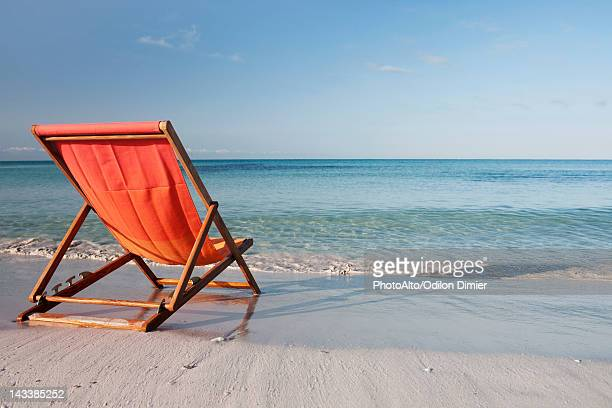 Empty deckchair on beach