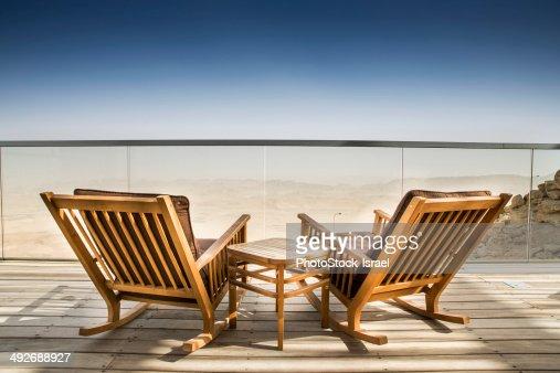 Empty deckchairs on wooden deck, Ramon Crater, Negev Desert, Israel