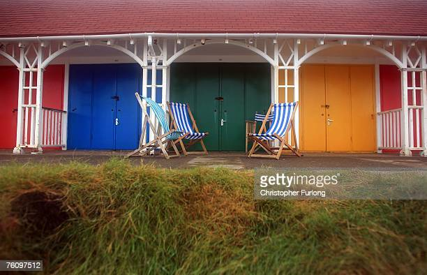 Empty deckchairs wait for holiday makers outside sea shore beach huts on 14 August Scarborough England The traditional British seaside holiday has...