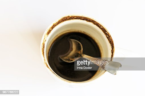 Empty dirty coffee cup on white table background. : Stock Photo
