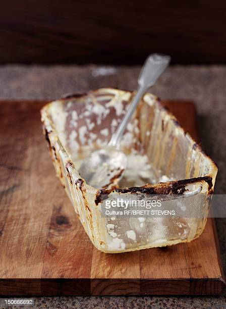 Empty dish with baked on cheese