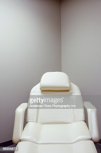 Empty examination chair in clinic
