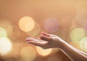 Empty female women open human hand prayer palms up Candle night light natural warm gold lantern bokeh Pray support aid destiny help peace campaign: Holy spirit week: World religion day: Eid mubarak