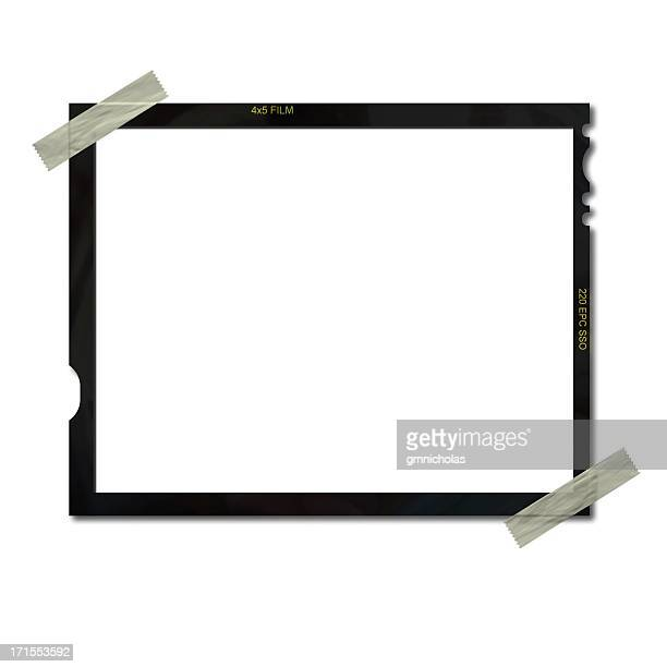 Empty film frame taped on upper left and lower right corners