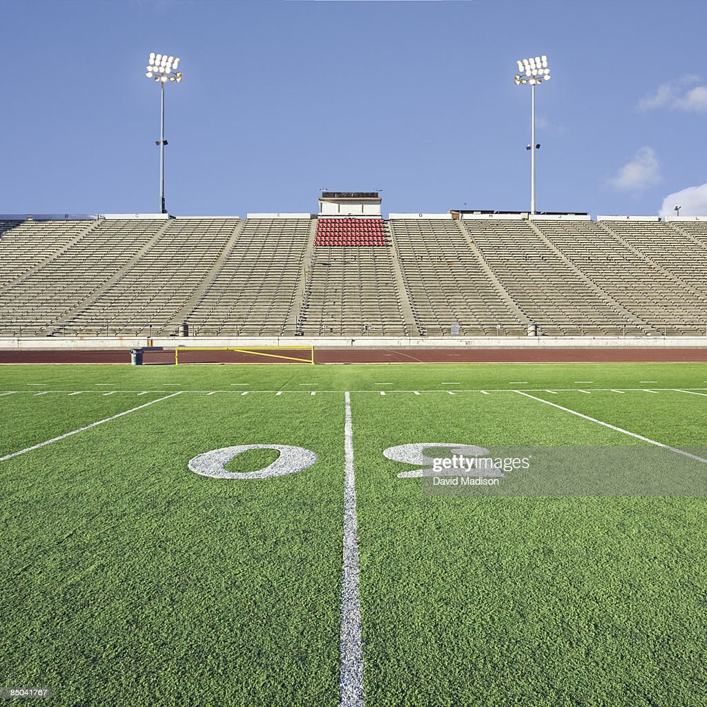 Empty football stadium with grandstands. : Stock Photo