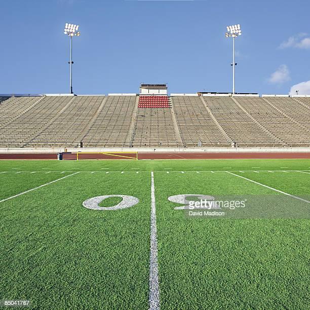 Empty football stadium with grandstands.