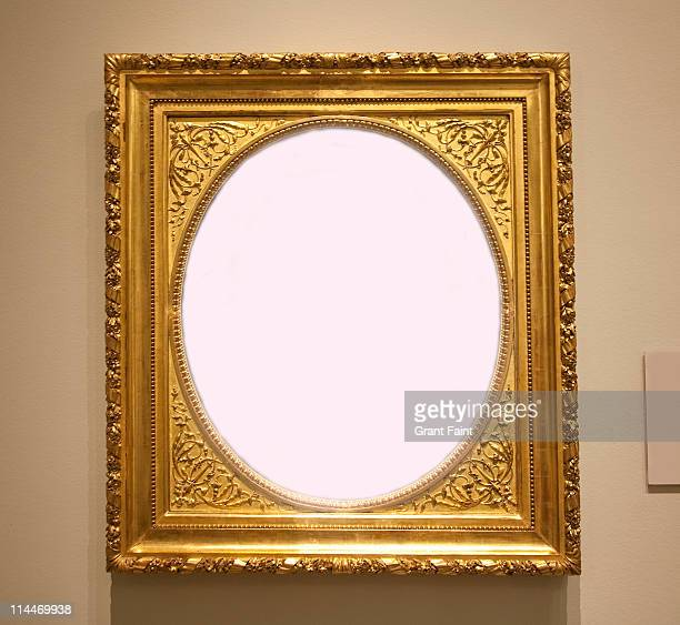 Empty frame hanging on wall.