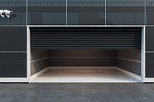 Front view of empty garage interior with camera and copy space. 3D Rendering