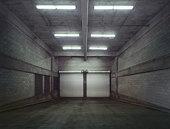 Empty garage with closed doors