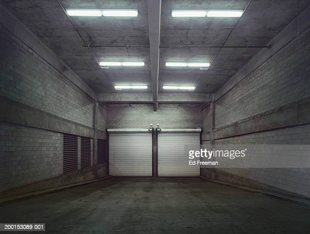 Empty garage with closed doors
