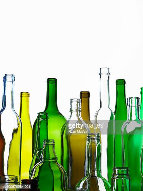 Empty glass bottles on white background