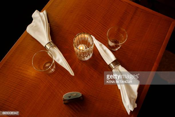 Empty glasses are seen on a table at the bar of the contemporary New York eatery Eleven Madison Park on April 05 2017 in New York The restaurant was...