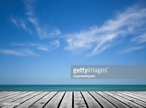 Empty gray wooden pier with sea and cloudy sky : Stock Photo