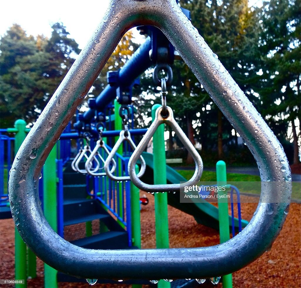 Empty gymnastic rings and slide on playground