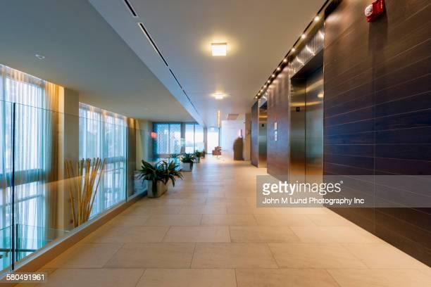 Empty hallway and elevators in modern office