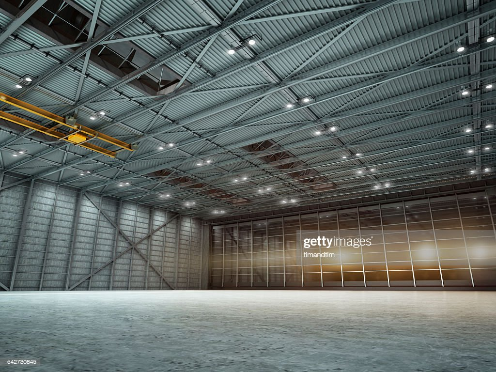 Empty hangar by night with lights on