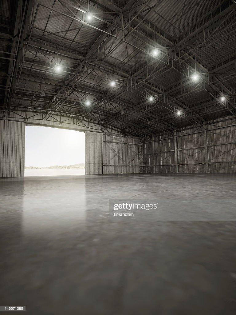 Empty hangar with lights on : Stock Photo