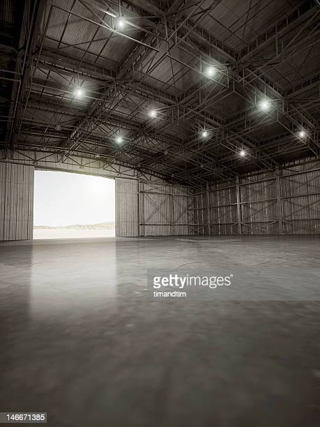 Empty hangar with lights on