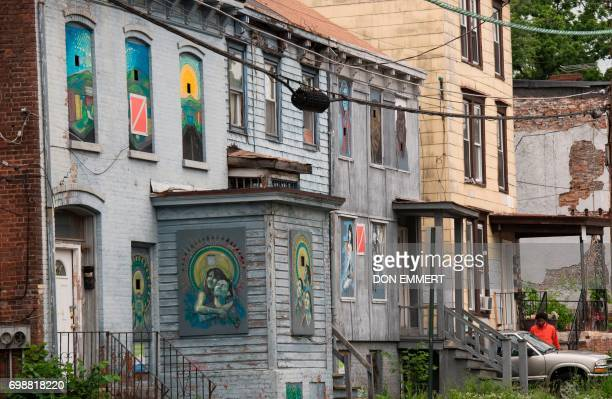 Empty homes with gray boards on the doors and windows can be seen on May 30 in Newburgh New York Rows of boardedup homes became a ubiquitous symbol...
