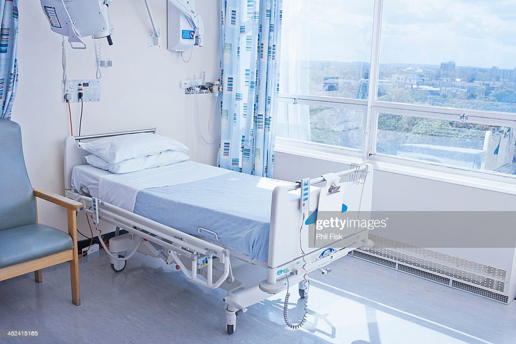 Empty hospital bed on hospital ward