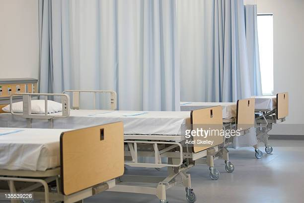 Empty hospital beds in hospital