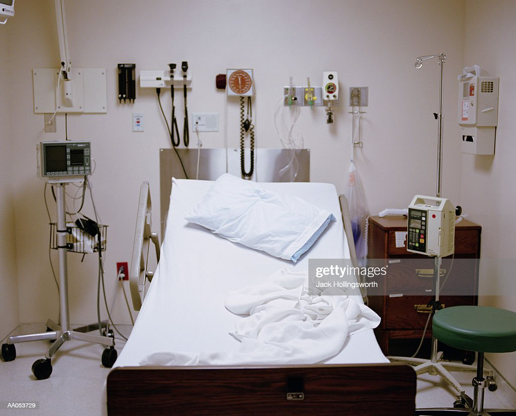 Empty hospital room with unmade bed : Stock Photo