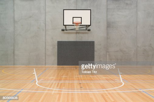 Empty indoor basketball court stock photo getty images for Free inside basketball courts
