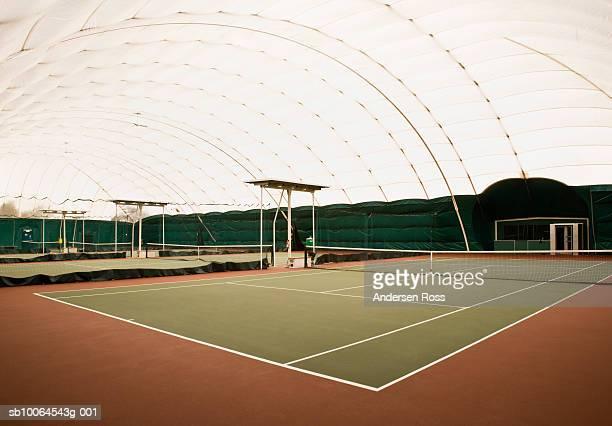 Empty indoor tennis courts