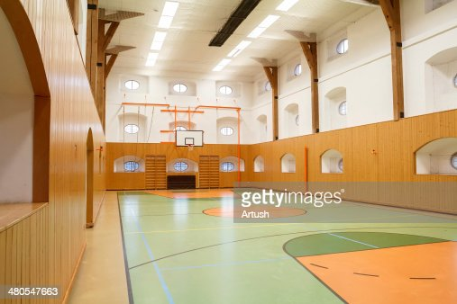 Empty interior of public gym with basketball court : Stock Photo