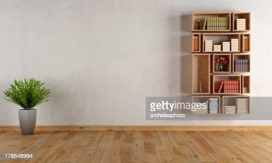 Empty interior with wall bookcase : Stock Photo