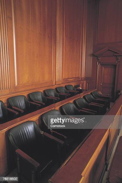 Empty jury box in courtroom
