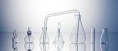 Empty laboratory glassware on bright blue background