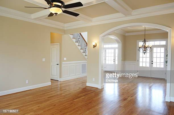 Empty large room with shiny wooden floor and clean walls