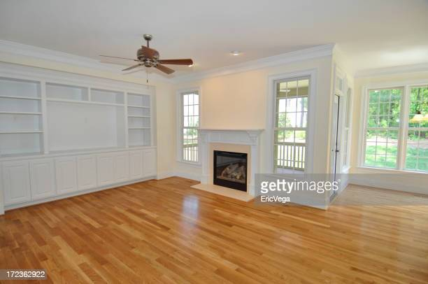 Empty Living Room of New House With Fireplace