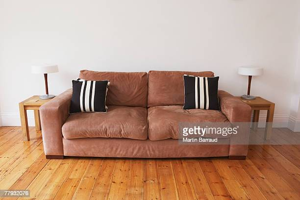 Empty living room with couch and end tables