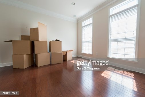 Empty Living Room With Moving Boxes Stock Photo