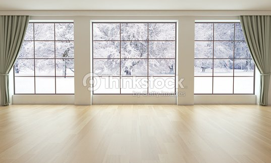 empty living room with snowy landscape stock photo
