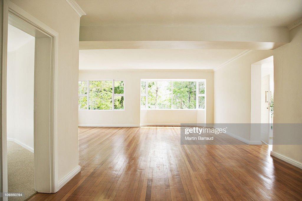 Hardwood Floor. RF. Empty Living Room With White Walls