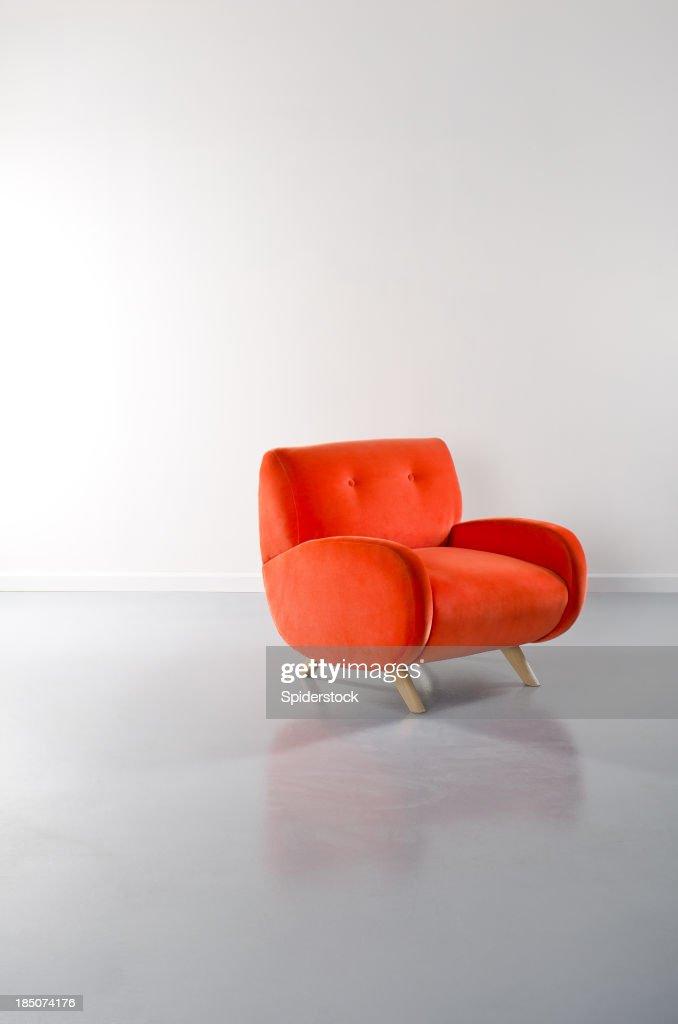 Empty Loft WIth Orange Armchair