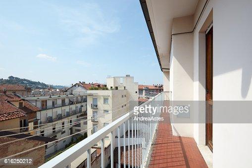 Empty, long balcony in a sunny day in Italy : Foto de stock