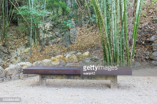 Empty long bench in the forest : Stockfoto