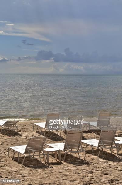 Empty lounge chairs on the beach, Sanibel Island, Florida, USA