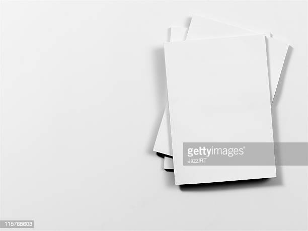 Empty magazine covers on white background