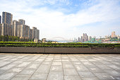 Empty marble floor with city architecture background