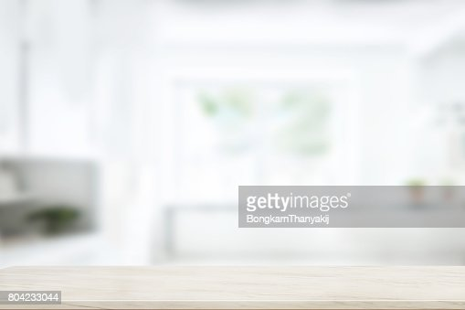 Empty marble table top in blurred modern kitchen room background. : Stock Photo