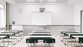 Interior of an empty modern classroom with interactive whiteboard.