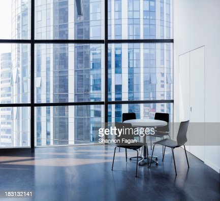 Empty modern office with table and four chairs : Stock Photo