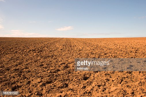Empty muddy field of red soil stock photo getty images for Soil uk tour 2016