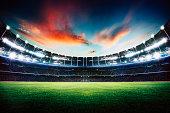 Empty night grand stadium with sport light , evening or night scene .