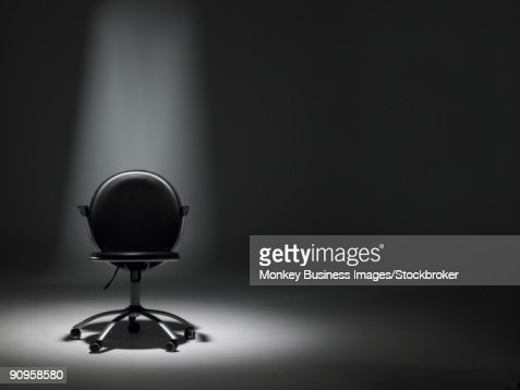 Empty Office Chair In Spotlight : Stock Photo